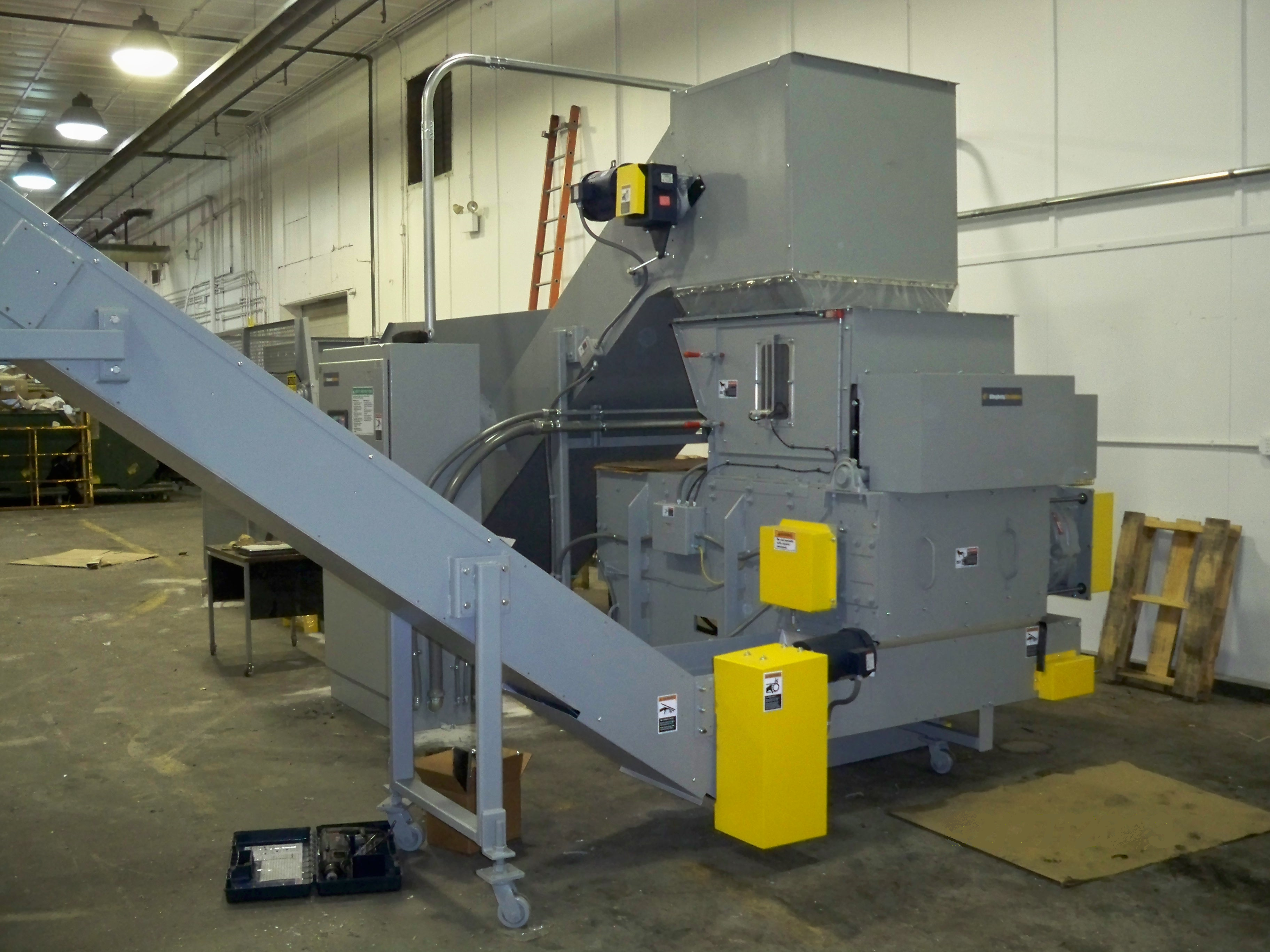 Security Grinder Shown with Optional Infeed Conveyor & Discharge Conveyor